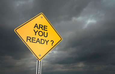 image of yellow sign in a storm saying Are You Ready? for Tornado Preparedness